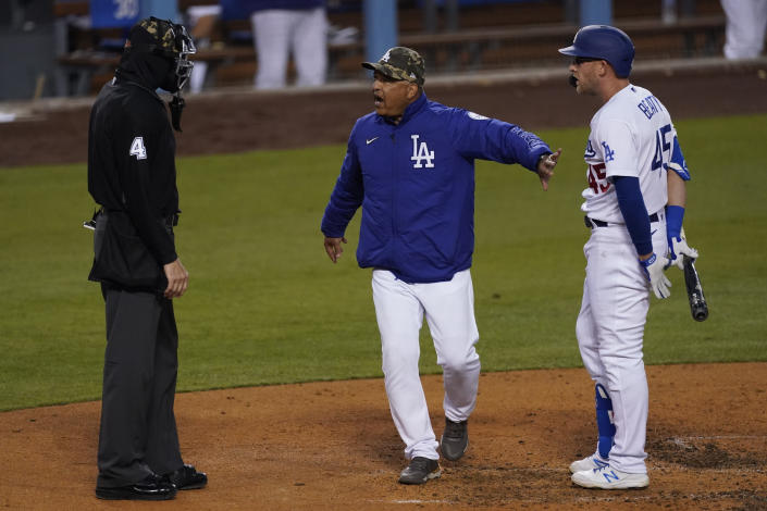 Los Angeles Dodgers manager Dave Roberts, center, gets between umpire Chad Fairchild (4) and Matt Beaty (45) after Beaty was called out on strikes during the fourth inning of a baseball game against the Miami Marlins Saturday, May 15, 2021, in Los Angeles. (AP Photo/Ashley Landis)
