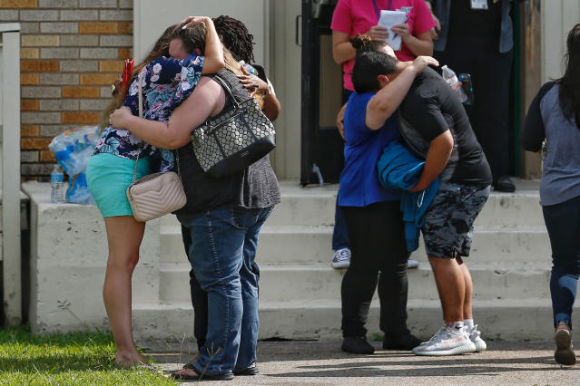 <p>People embrace outside the Alamo Gym where students and parents wait to reunite following a shooting at Santa Fe High School Friday, May 18, 2018, in Santa Fe, Texas. (Photo: Michael Ciaglo/Houston Chronicle via AP) </p>