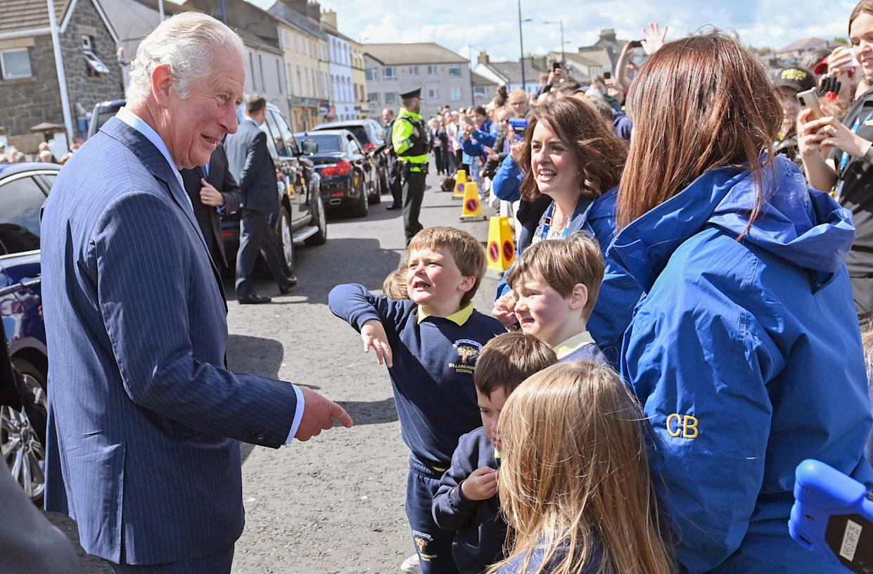BANGOR, NORTHERN IRELAND - MAY 19: Prince Charles, Prince of Wales meets wellwishers as he arrives to view stones which line the Donaghadee Harbour walls and were decorated with messages of hope by local people during the pandemic on May 19, 2021 in Bangor, Northern Ireland. (Photo by Samir Hussein - Pool/WireImage)