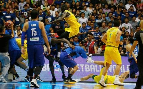 """Basketball's international governing body has opened disciplinary hearings against Australia and the Philippines after a wild brawl that included Milwaukee Bucks forward Thon Maker broke out in their Basketball World Cup qualifying game on Monday. The fight spilled into the area behind the baseline and video showed a chair being thrown at the back of an Australia player either by a fan or member of the Philippines team staff. Former NBA player Andray Blatche, now playing for the Philippines, appeared to throw multiple punches, while Maker came at a Philippines player with legs flying high as it continued. A total of 13 players were ejected after the melee that began in the third quarter of Australia's 89-53 victory following a collision in the lane. The game continued with just three players from the Philippines. Maker said he was """"deeply disappointed"""" by the violence. The Philippines and Australian basketball players react, during the FIBA World Cup Qualifiers at the Philippine Arena in suburban Bocaue township Credit: AP """"I take responsibility for my actions knowing that they are a result of MY DESIRE to protect my teammates and myself,"""" he wrote on Twitter. pic.twitter.com/QMX3J5u6fT— Thon Maker ™ (@ThonMaker14) July 3, 2018 Anthony Moore, chief executive of Australian basketball, apologised to fans in a statement, adding that """"this is not the spirit in which sport should be played and certainly not in the spirit in which we aim to play basketball"""". The Australians later tweeted that everyone on their team was safe and well. The Bucks said they would have no comment about Maker. FIBA says a decision will be announced in the coming days."""
