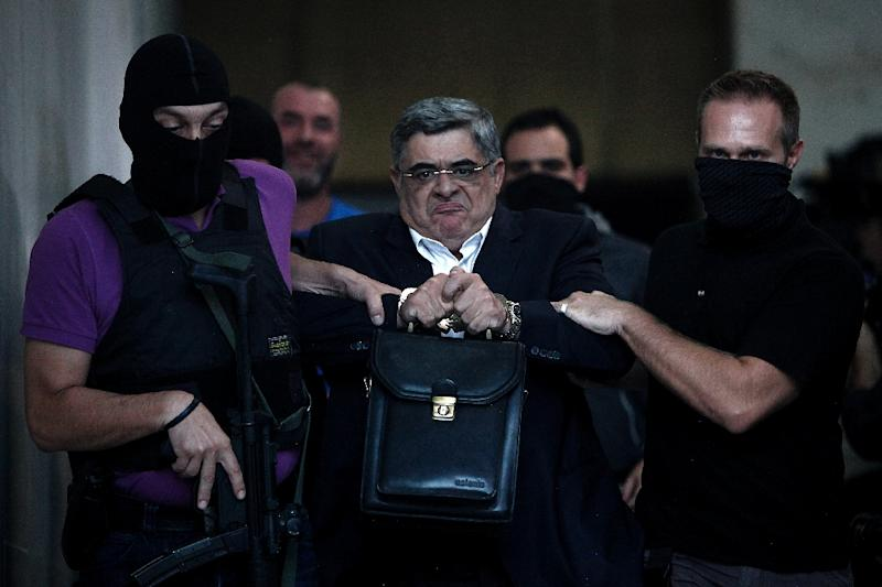 Leader of ultra-right wing Golden Dawn party Nikos Michaloliakos escorted by police officers to the prosecutor in Athens on September 28, 2013 (AFP Photo/Angelos Tzortzinis)