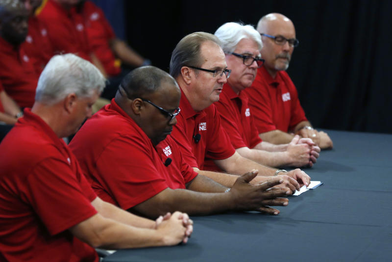 United Auto Workers President Gary Jones, third from left, opens contract talks with the Ford Motor Co., Monday, July 15, 2019, in Dearborn, Mich. (AP Photo/Carlos Osorio)