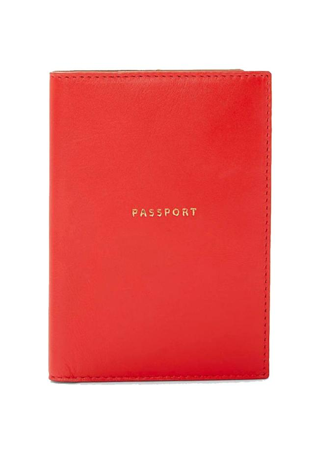 "<p><a class=""body-btn-link"" href=""https://www.johnlewis.com/john-lewis-partners-ali-leather-passport-cover/fiesta/p3903101"" target=""_blank"">SHOP NOW</a> £20.00, John Lewis </p><p>An 'I'm about to go on holiday' Instagram essential.</p>"