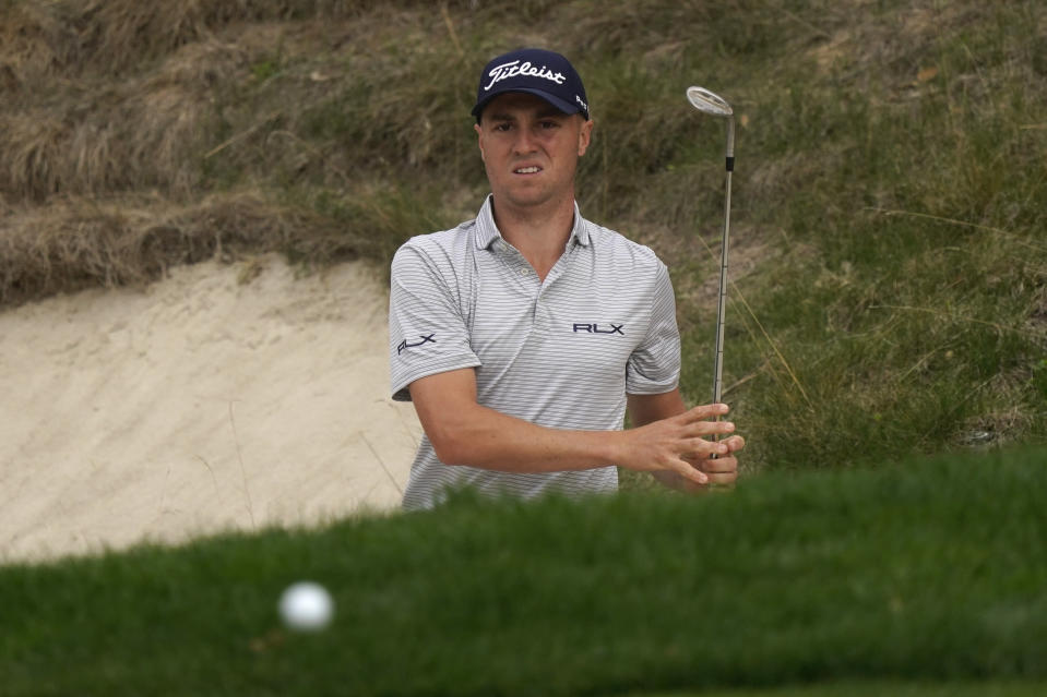 Justin Thomas hits from the bunker to the eighth green during the second round of the Zozo Championship golf tournament Friday, Oct. 23, 2020, in Thousand Oaks, Calif. (AP Photo/Marcio Jose Sanchez)