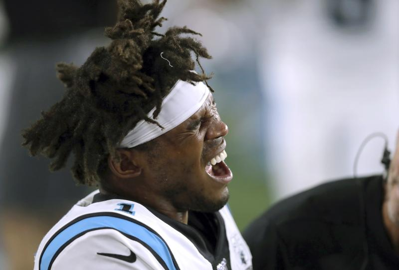 Carolina Panthers quarterback Cam Newton grimaces as he receives attention on the sideline after an injury in the first half of an NFL preseason football game against the New England Patriots, Thursday, Aug. 22, 2019, in Foxborough, Mass. (AP Photo/Charles Krupa)