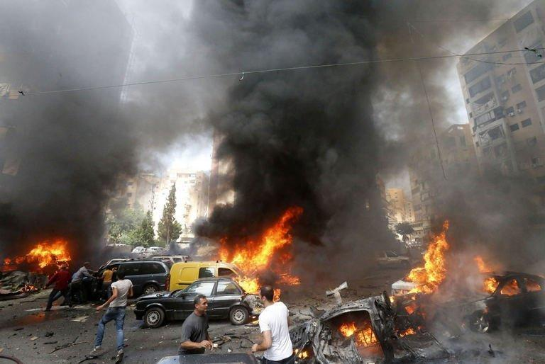 Cars burn after an explosion in Beirut's southern suburb neighbourhood of Bir al-Abed on July 9, 2013. The bomb injured at least 53 people in the most serious incident in the stronghold of Lebanon's Shiite Hezbollah movement since the start of the Syrian conflict