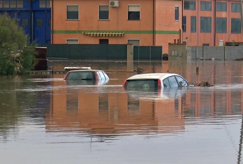 Submerged cars are seen on a flooded street in San Gavino Monreale on Sardina island November 18, 2013. Italian authorities declared a state of emergency in Sardinia on Tuesday, a day after a cyclone struck the Mediterranean island, killing at least 16 people and leaving hundreds homeless. Overnight, Cyclone Cleopatra dropped 450 millimetres of rain in an hour and a half, causing rivers to burst their banks, sweeping away cars and flooding homes across the island. Picture taken November 18, 2013. REUTERS/Rosaspress (ITALY - Tags: DISASTER ENVIRONMENT)