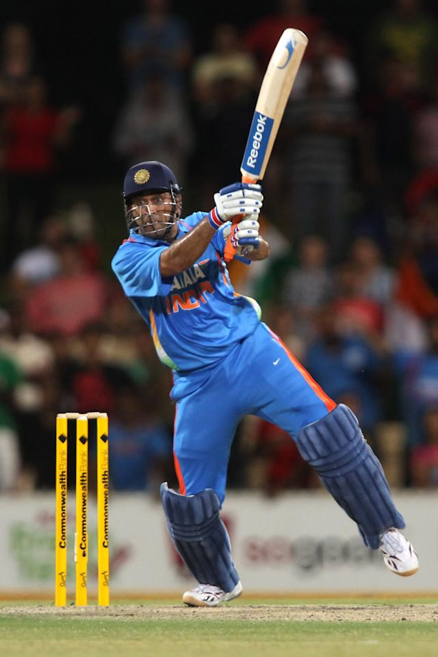 ADELAIDE, AUSTRALIA - FEBRUARY 14:  MS Dhoni of India hits the last ball of the innings during the One Day International match between India and Sri Lanka at Adelaide Oval on February 14, 2012 in Adelaide, Australia.  (Photo by Morne de Klerk/Getty Images)