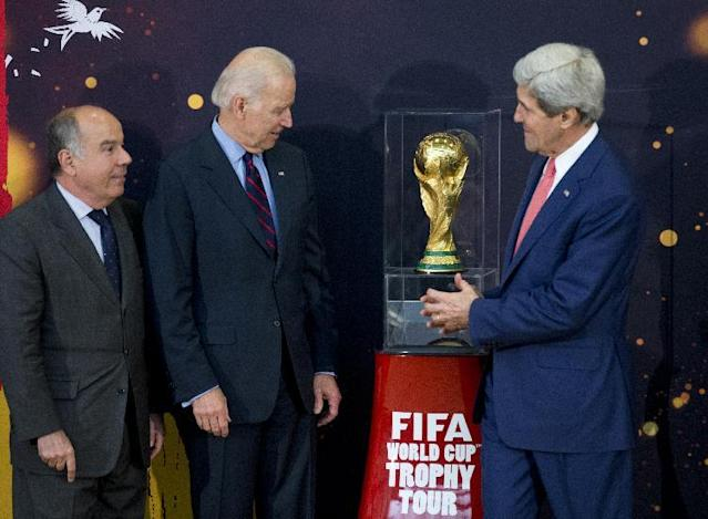 From left, Brazil's Ambassador to the US Mauro L.I. Vieira, Vice President Joe Biden, and Secretary of State John Kerry, look at the FIFA World Cup trophy, the actual trophy that will be awarded to the winner of this year's World Cup soccer tournament in Brazil, Monday, April 14,2014, during an unveiling ceremony at the State Department in Washington. (AP Photo/Manuel Balce Ceneta)