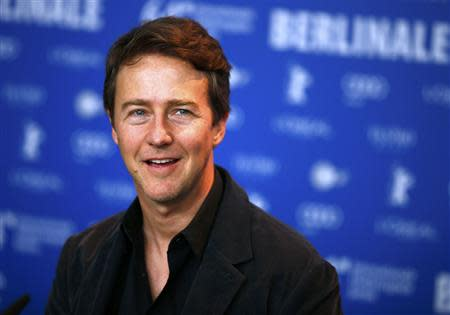 """Actor Edward Norton smiles during a photocall to promote the movie """"The Grand Budapest Hotel"""" at the 64th Berlinale International Film Festival in Berlin February 6, 2014. REUTERS/Thomas Peter"""
