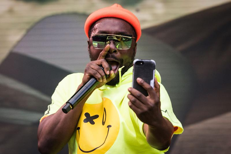 US rap singer Will.I.Am performs with the Black Eyed Peas group during the Vieilles Charrues music festival on July 20, 2019 in Carhaix-Plouguer, western France. (Photo by LOIC VENANCE / AFP) (Photo credit should read LOIC VENANCE/AFP via Getty Images)