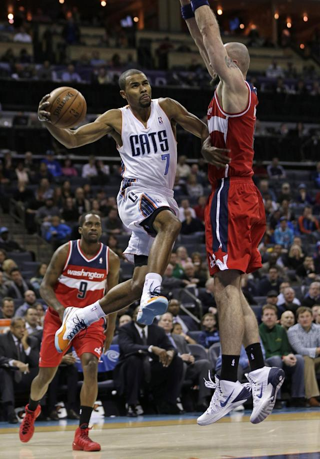 Charlotte Bobcats' Ramon Sessions, center, drives between Washington Wizards' Marcin Gortat, right, and Martell Webster (9) during the first half of an NBA basketball game in Charlotte, N.C., Tuesday, Jan. 7, 2014. (AP Photo/Chuck Burton)