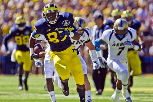 Michigan tight end Devin Funchess (87) rushes for a touchdown in the first quarter of an NCAA college football game against Akron, Saturday, Sept. 14, 2013, in Ann Arbor, Mich. (AP Photo/Tony Ding)