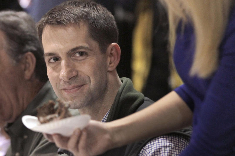 In this photo taken Saturday, Jan. 11, 2014, U.S. Rep. Tom Cotton, R-Ark., attends the Gillett Coon Supper in Gillett, Ark. Cotton is challenging U.S. Sen. Mark Pryor, D-Ark., in the 2014 election. (AP Photo/Danny Johnston)