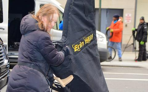 Harpist Erin Hill arrives at the hotel - Credit: Splash
