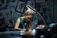 Ngoc was ridiculed when she started out as a tattoo artist in Hanoi less than a decade ago -- with many assuming she did not go into the industry out of choice