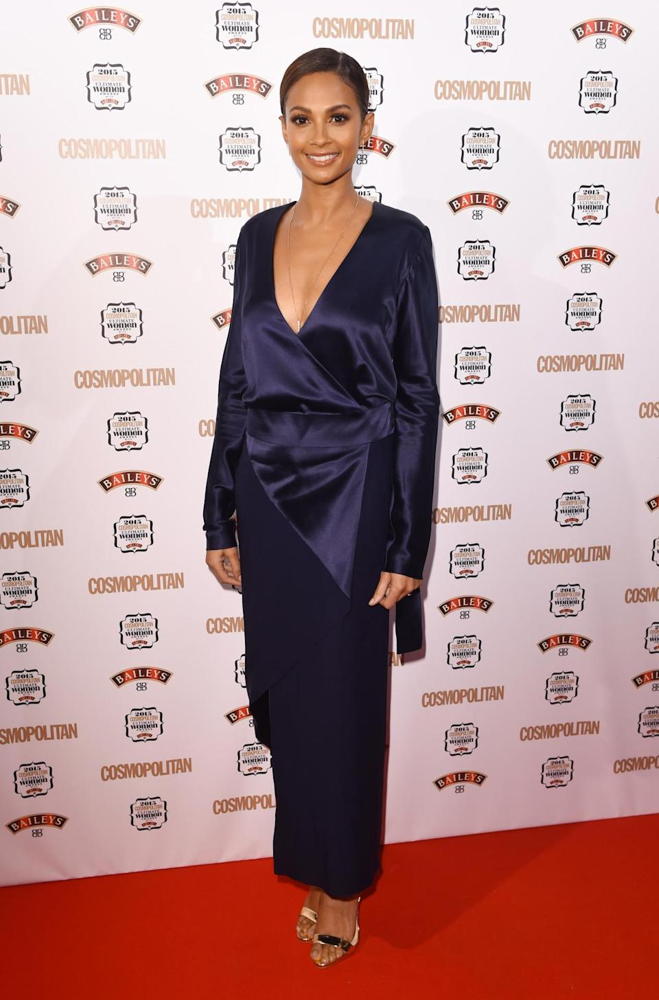 Alesha Dixon opted for a satin wrap dress with a plunging neckline and slicked her locks back. [Photo: Rex]