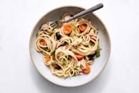 """This fresh take on tuna pasta salad is excellent warm, but on a hot day, you can eat it straight out of the refrigerator. <a href=""""https://www.epicurious.com/recipes/food/views/spaghetti-with-tuna-tomatoes-and-olives-56389800?mbid=synd_yahoo_rss"""" rel=""""nofollow noopener"""" target=""""_blank"""" data-ylk=""""slk:See recipe."""" class=""""link rapid-noclick-resp"""">See recipe.</a>"""