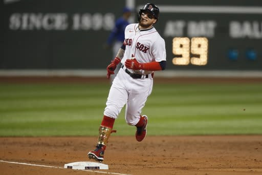 Boston Red Sox's Alex Verdugo (99) rounds third base on his solo home run during the second inning of a baseball game against the Toronto Blue Jays, Friday, Aug. 7, 2020, in Boston. (AP Photo/Michael Dwyer)