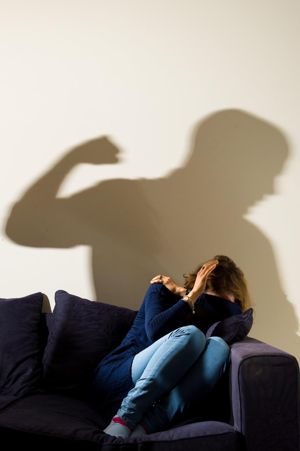 A shadow of a man with a clenched fist (PA Archive)