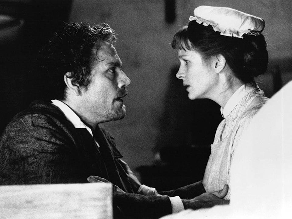 John Malkovich and Julia Roberts as Henry Jekyll and Mary Reilly, respectively.