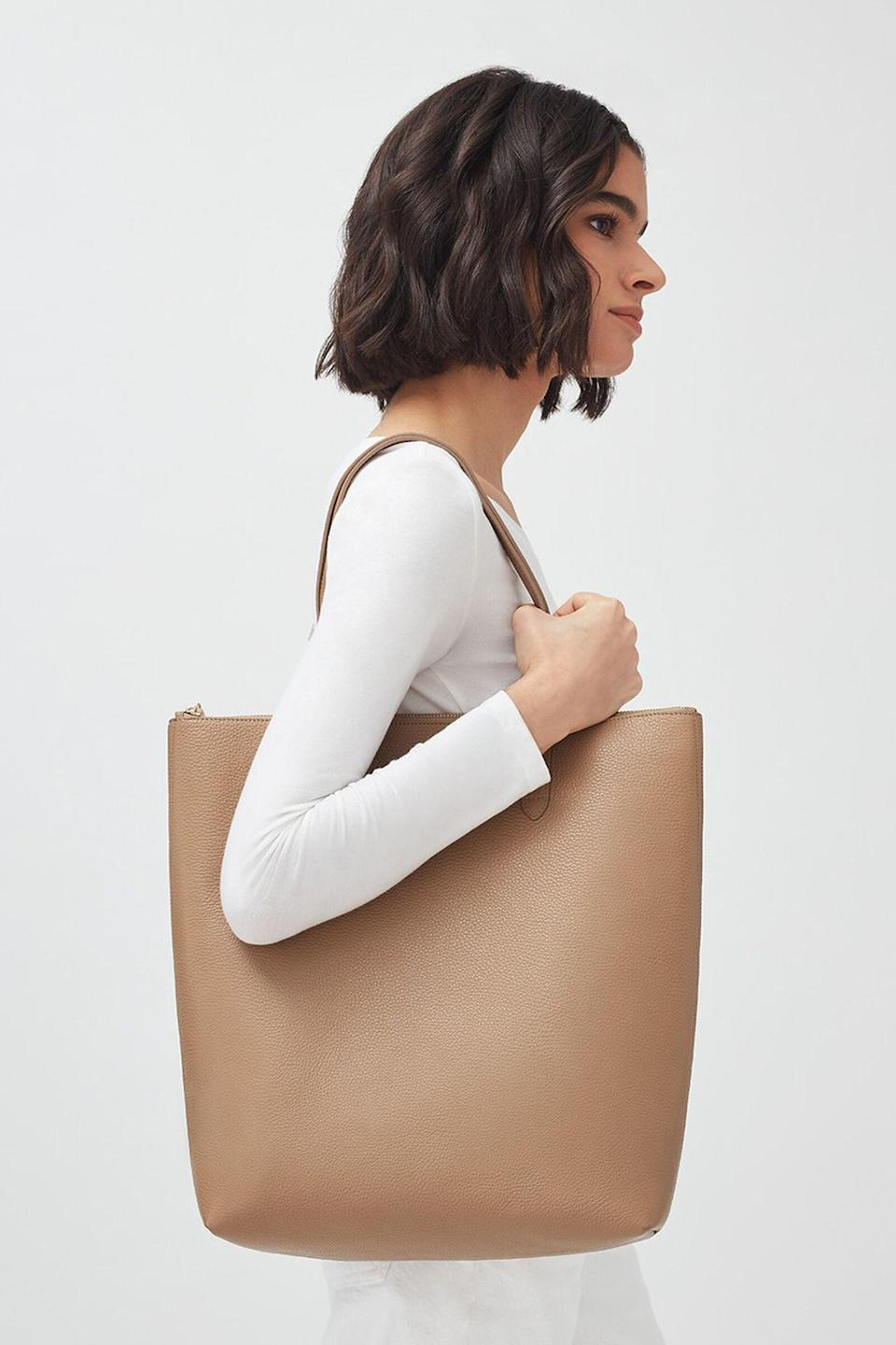 <p>The shape of this <span>Cuyana Tall Structured Leather Zipper Tote</span> ($215) is perfect for your laptop and more. Plus, it's super deep, which means you can fit a lot in there.</p>