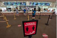 <p>ovie goers social distance at the AMC Highlands Ranch 24 on August 20 in Highlands Ranch, Colorado.</p>