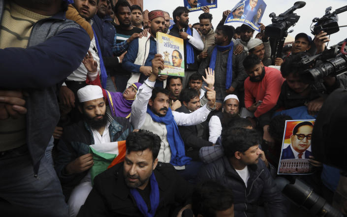 Chandrashekhar Azad, leader of the Bhim Army, a political party of Dalits who represent the Hinduism's lowest caste, center, leads a protest against a new Citizenship law, after Friday prayers in New Delhi, India, Friday, Jan. 17, 2020. Protests against India's citizenship law that excludes Muslim immigrants continue in Indian cities in an unabating strong show of dissent against the Hindu nationalist government of Prime Minister Narendra Modi. Azad was arrested on Dec. 21 after leading a similar protest at the steps of the 17th century Jama Masjid mosque, accused of instigating violence as the protest had ended in a clash between the protesters and the police. He was ordered released from prison on Thursday by a New Delhi court. (AP Photo/Manish Swarup)