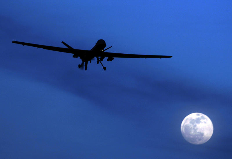 FILE - This Jan. 31, 2010 file photo shows a U.S. Predator drone flies over the moon above Kandahar Air Field, southern Afghanistan. U.S. and Pakistani officials say Pakistan's intelligence chief will head to Washington late this month to resume counterterrorism talks suspended over a deadly border incident last year that killed two dozen Pakistani troops. (AP Photo/Kirsty Wigglesworth, File)