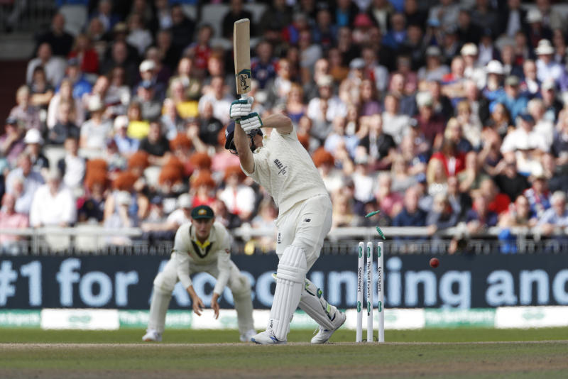 England's Jos Buttler is bowled out during day four of the fourth Ashes Test cricket match between England and Australia at Old Trafford in Manchester, England, Saturday, Sept. 7, 2019. (AP Photo/Rui Vieira)