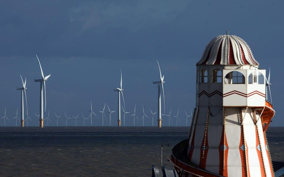 Offshore wind turbines off the coast past the Clacton Pier in Clacton On Sea - Chris Ratcliffe/Bloomberg