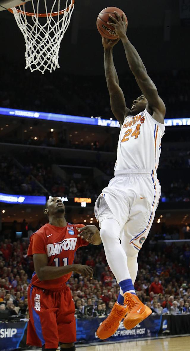 Florida forward Casey Prather (24) shoots against Dayton guard Scoochie Smith (11) during the first half in a regional final game at the NCAA college basketball tournament, Saturday, March 29, 2014, in Memphis, Tenn. (AP Photo/Mark Humphrey)