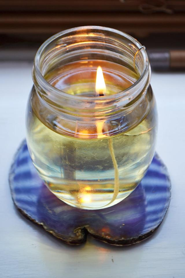 "<p>Thanks to the citronella in this <a href=""http://wallflowerkitchen.com/diy-olive-oil-candle-lamp/"" target=""_blank"" class=""ga-track"" data-ga-category=""Related"" data-ga-label=""http://wallflowerkitchen.com/diy-olive-oil-candle-lamp/"" data-ga-action=""In-Line Links"">olive oil lamp</a> it acts as a natural bug repellent, and because it's a ""lamp"" it gives off more light than an average candle. </p>"