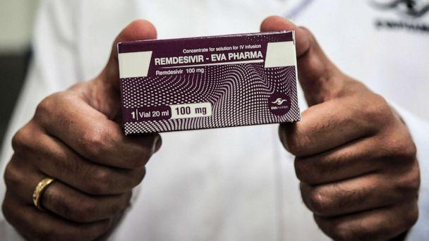 PHOTO: An employee of Egyptian pharmaceutical company Eva Pharma holds a pack containing vials of remdesivir, a broad-spectrum antiviral medication approved as a specific treatment for COVID-19. (Fadel Dawood/Picture Alliance via Getty Images)
