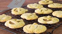 """<p>Looking for a sweet Halloween treat? Make these pumpkin-shaped cookies using <a href=""""https://www.thedailymeal.com/cook/dishes-make-with-canned-pumpkin-recipes?referrer=yahoo&category=beauty_food&include_utm=1&utm_medium=referral&utm_source=yahoo&utm_campaign=feed"""" rel=""""nofollow noopener"""" target=""""_blank"""" data-ylk=""""slk:canned pumpkin"""" class=""""link rapid-noclick-resp"""">canned pumpkin</a>, brown sugar, pumpkin pie spice, heavy cream and more for a yummy filling.</p> <p><a href=""""https://www.thedailymeal.com/recipes/pumpkin-pie-cookies-recipe-0?referrer=yahoo&category=beauty_food&include_utm=1&utm_medium=referral&utm_source=yahoo&utm_campaign=feed"""" rel=""""nofollow noopener"""" target=""""_blank"""" data-ylk=""""slk:For the Pumpkin Pie Cookies recipe, click here."""" class=""""link rapid-noclick-resp"""">For the Pumpkin Pie Cookies recipe, click here.</a></p>"""
