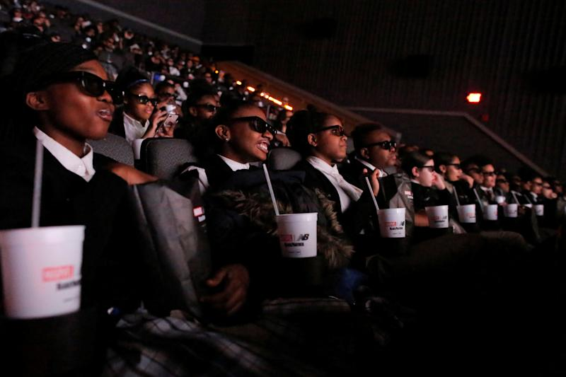"A group of students from the Capital Preparatory Harlem School watch the film ""Black Panther"" on its opening night at the AMC Magic Johnson Harlem 9 cinemas in New York on Feb. 15, 2018."