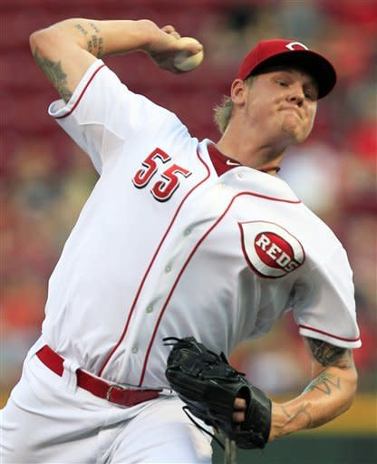 Cincinnati Reds starting pitcher Mat Latos throws against the Philadelphia Phillies in the first inning of a baseball game, Tuesday, Sept. 4, 2012, in Cincinnati. (AP Photo/Al Behrman)