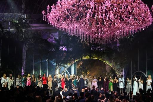The biggest amount -- 1.6 million euros -- raised was for a collection of designer dresses modelled by a bevy of catwalk stars. A bidding war erupted after the models offered to each bestow a kiss on the winner