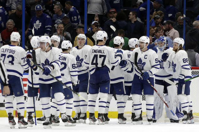 The Toronto Maple Leafs celebrate their win over the Tampa Bay Lightning during an NHL hockey game Tuesday, Feb. 25, 2020, in Tampa, Fla. (AP Photo/Chris O'Meara)