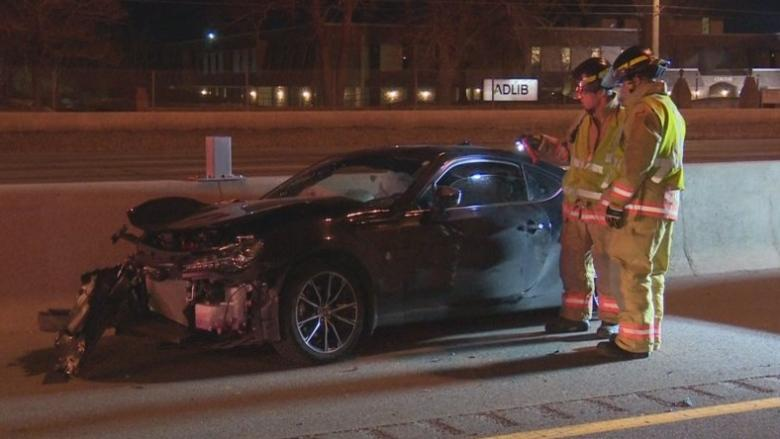 One person in life-threatening condition after suspected street racing crash