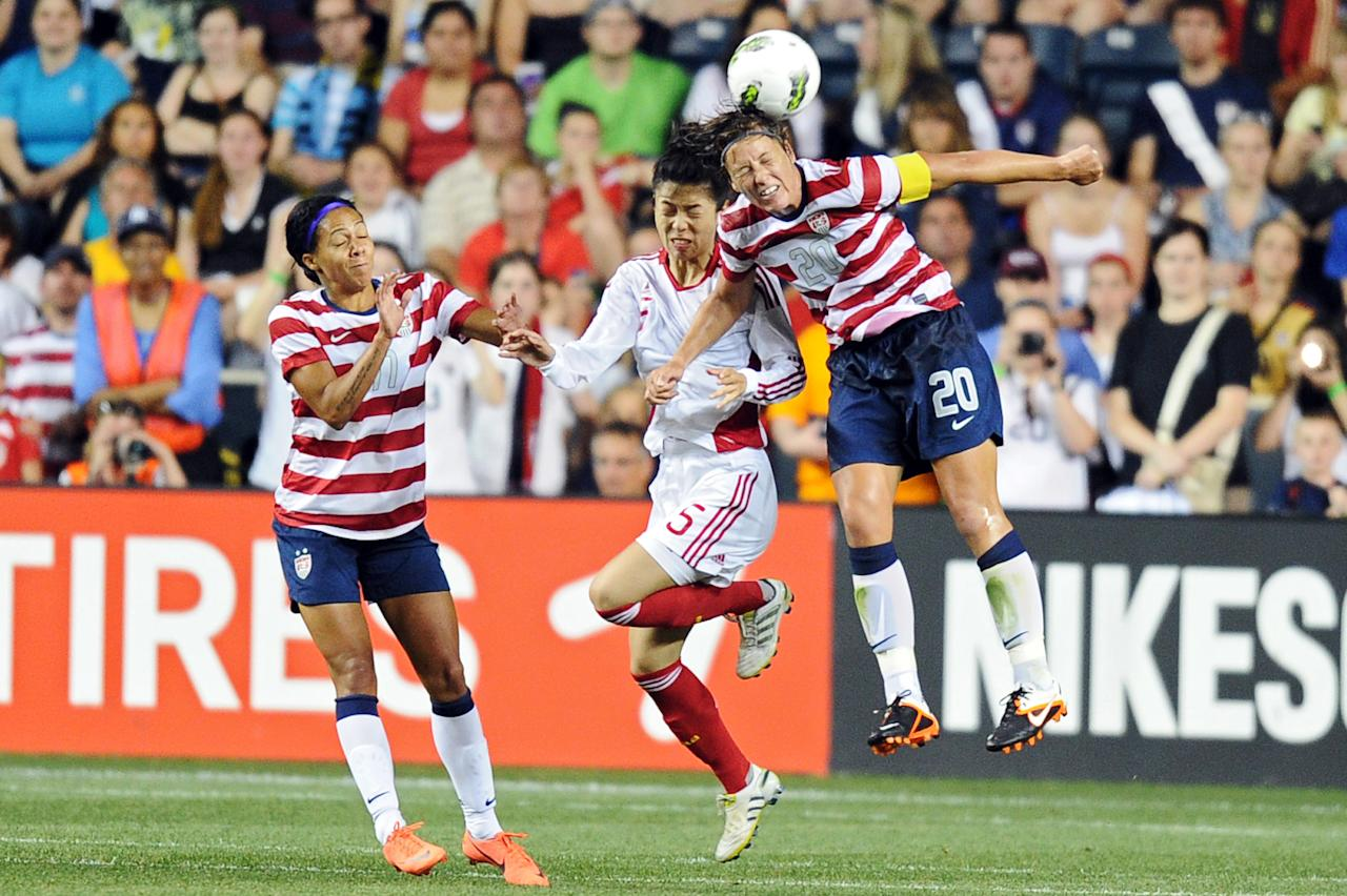CHESTER, PA - MAY 27: Sydney Leroux #11 and Abby Wambach #20 of the USA battle to head the ball against Wang Dongni #5 of the China at PPL Park on May 27, 2012 in Chester, Pennsylvania. USA won 4-1. (Photo by Drew Hallowell/Getty Images)