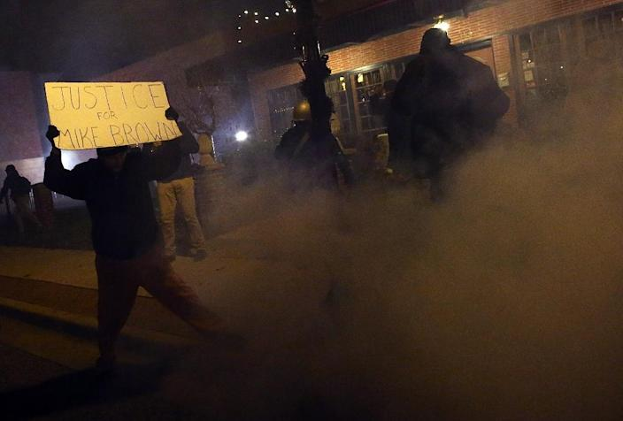 A protester is surrounded by tear gas during a demonstration on November 24, 2014 in Ferguson, Missouri (AFP Photo/Justin Sullivan)
