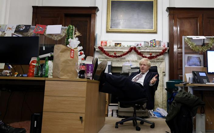 The Prime Minister in his office in December. He is hoping for donations to spruce up the decor - ANDREW PARSONS
