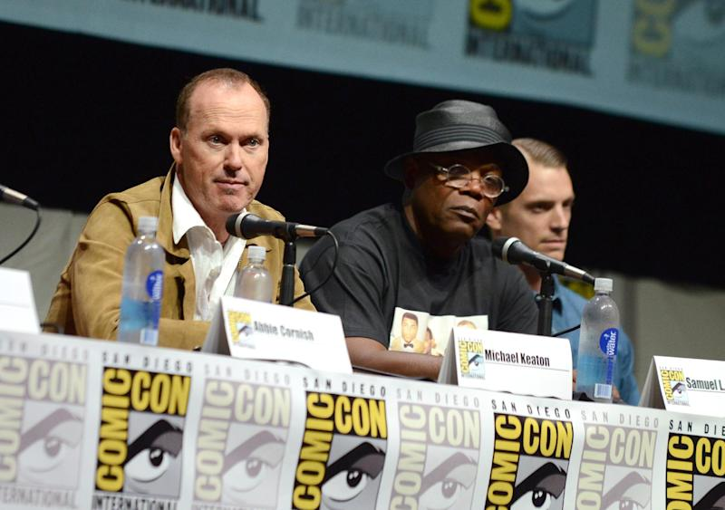 "Michael Keaton, left, Samuel L. Jackson, center, and Joel Kinnaman attend the ""RoboCop"" panel on Day 3 of Comic-Con International on Friday, July 19, 2103 in San Diego.. (Photo by Jordan Strauss/Invision/AP)"