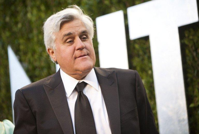"This file photo shows Jay Leno arriving to the Vanity Fair Oscar Party in West Hollywood, California, on February 26, 2012. America's late-night TV hosts appear set for a new shake-up, with veteran ""Tonight Show"" presenter Leno said to be hanging up his microphone after falling out with his NBC bosses"