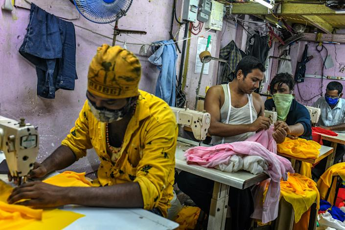 """My family was worried about the disease and didn't want me to return to the city, but I had to come back to work,"" said Ishrar Ali, who stitches women's tops in a garment workshop in Dharavi. <span class=""copyright"">Atul Loke for TIME</span>"