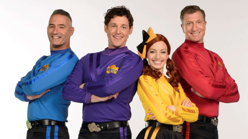 The Wiggles posing in their uniforms
