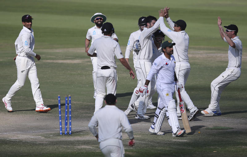 New Zealand's players celebrate dismissal of Pakistan's Sarfraz Ahmed in their test match in Abu Dhabi, United Arab Emirates, Friday, Dec. 7, 2018. (AP Photo/Kamran Jebreili)