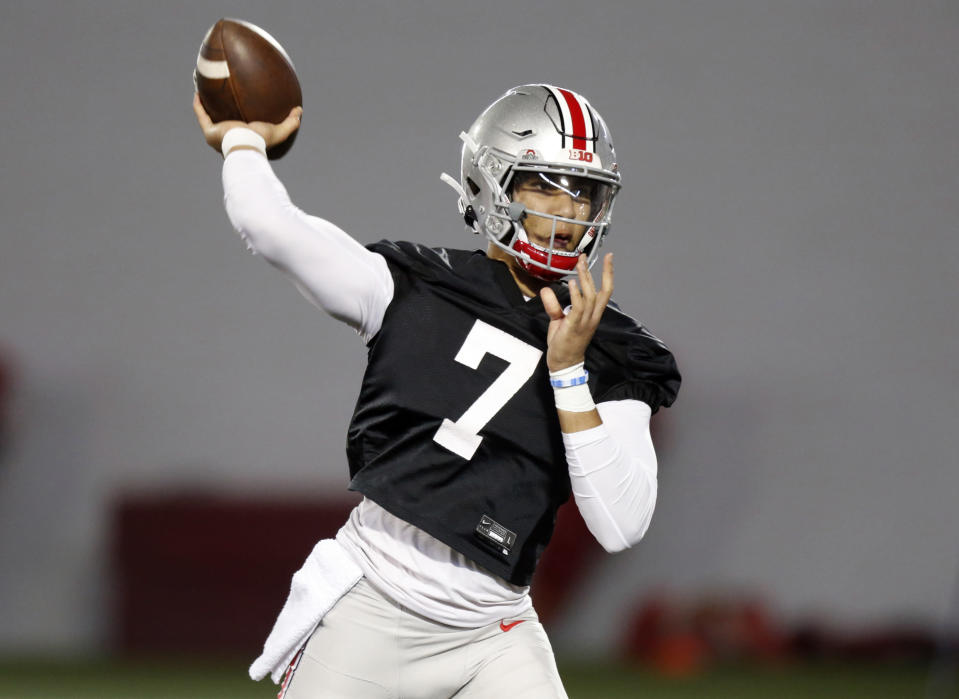 FILE - Ohio State quarterback C.J. Stroud passes during an NCAA college football practice in Columbus, Ohio, in this Monday, April 5, 2021, file photo. With two-time Big Ten player of the year Justin Fields departing for the NFL, returning backups C.J. Stroud and Jack Miller III and five-star January enrollee Kyle McCord took the snaps in spring practice. Stroud was believed to be the front-runner entering the spring, but coach Ryan Day said a starter might not be determined until the week of the Sept. 2 opener at Minnesota.(AP Photo/Paul Vernon, File)
