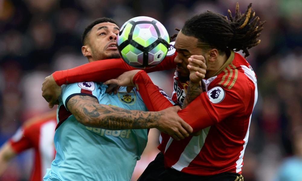 Burnley's Andre Gray contests the ball with Sunderland's Jason Denayer.